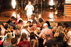 Group prayer at Cornerstone